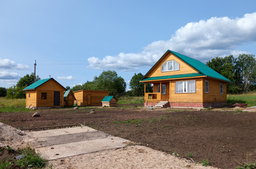 New wooden house at the village in summertime