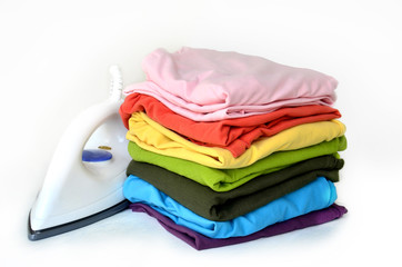 Stacks clothes with iron