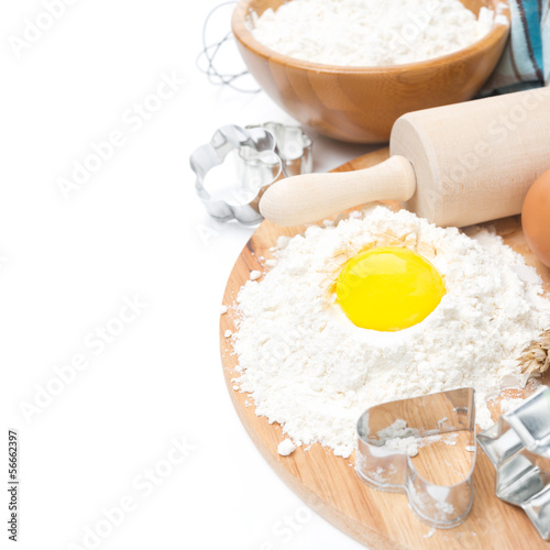 ingredients for baking cookies - flour, egg and baking forms