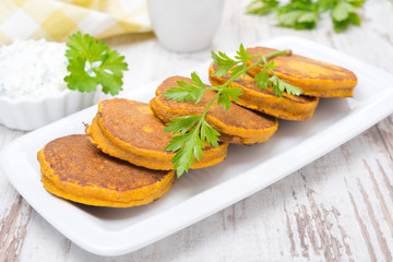 Pumpkin fritters with herbs