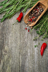 Spices and herbs on a wooden background (and space for text)