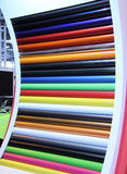 A Display of Brightly Coloured Rolls of Material.