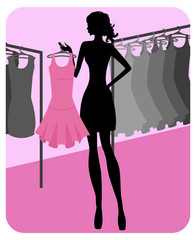 Silhouette of beautiful girl chooses clothes in shop