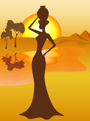 Silhouette of african girl with a pitcher goes to fetch water