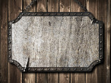 medieval signboard on wooden wall