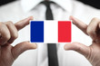 Businessman holding a business card with a France Flag