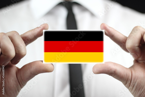 Businessman holding a business card with a Germany Flag