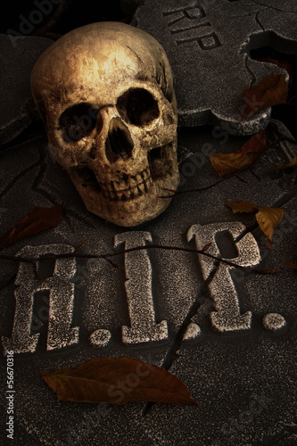 Creepy skull on gravestone