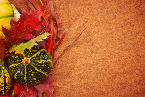 Pumpkins with fall leaves with seasonal background