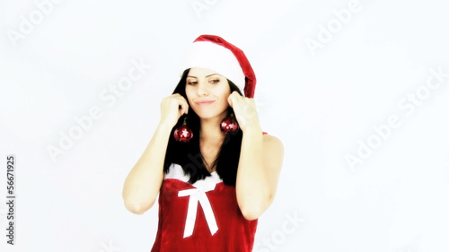 Beautiful female santa claus playing for christmas