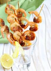 shrimp grilled on wooden skewers with lemon