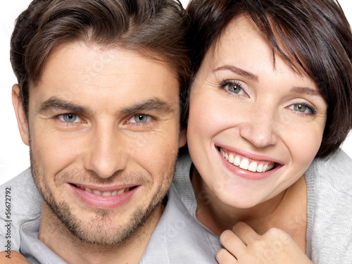 Closeup face of beautiful  happy couple - isolated