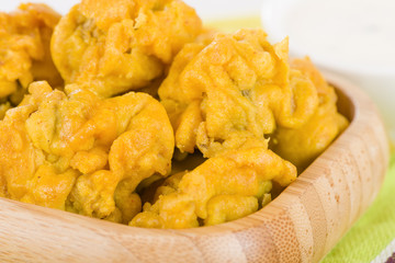 Mushroom Pakora - Indian snack of battered and fried mushrooms.