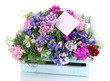 Beautiful bouquet in basket isolated on white