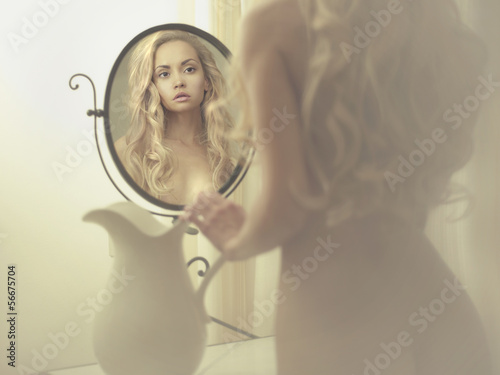 Seductive woman in the mirror