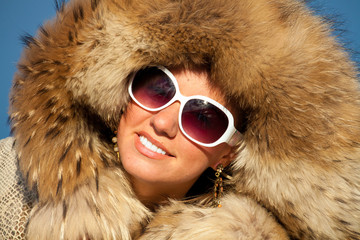 portrait of nice girl in fox fur
