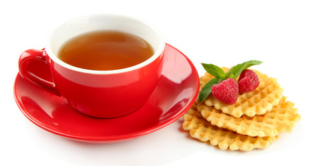 Cup of tea with cookies and raspberries isolated on white