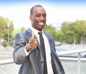 Businessman with successful gesture