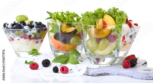 Fruit salad in glasses, isolated on white
