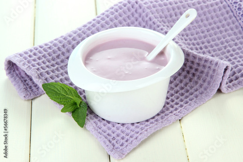 Delicious yogurt on table close-up