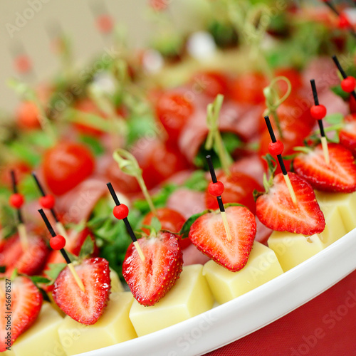 Appetizers, gourmet food - canape with cheese and strawberries,