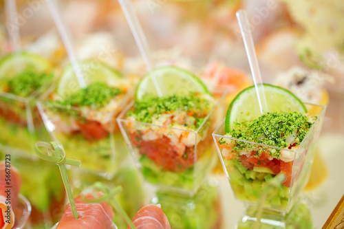 Appetizers, gourmet food - vegetable salad and prosciutto, cater
