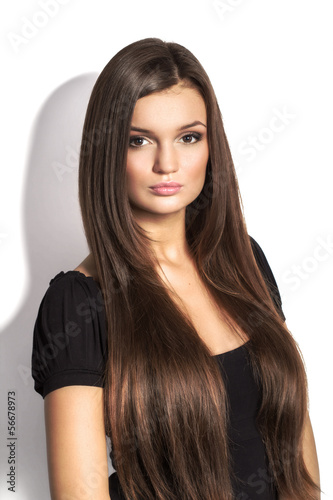 Portrait of beautiful  woman with long brown hair on white backg