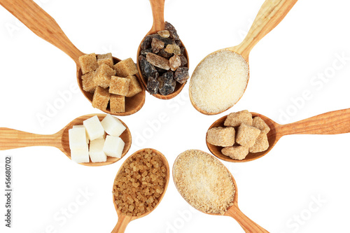 Different types of sugar in spoons isolated on white
