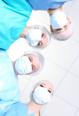 View from below of surgeons in protective work wear during