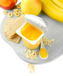Tasty yogurt in open plastic cup, cookies and fruit,