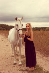 beautiful young woman with a  horse