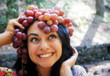 Beautiful girl with hat of grape