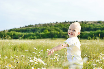 boy running in field