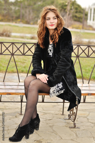 teen girl sitting on the bench