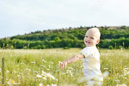boy running in field