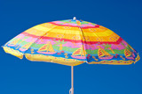 Colorful parasol at the background of blue sky