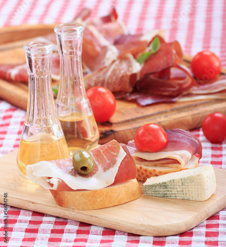 sliced prosciutto with olive cheese Cherry tomato and .schnapps.