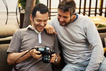 Two friends looking at photos in camera