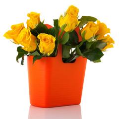 Bouquet yellow roses in orange vase