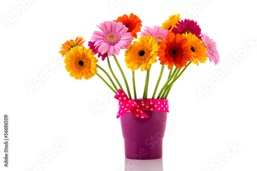Purple vase with colorful flowers