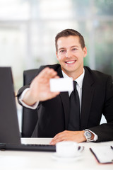 young businessman presenting business card