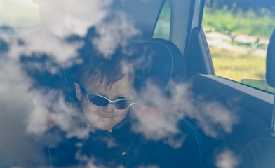 Boy in car with glasses