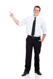 young businessman pointing at copy space