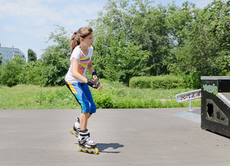 Pretty young teenage girl roller skating