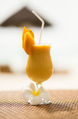 Fresh mango juice on a tropical beach