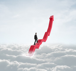 man climbing a red sky