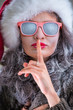 Woman wearing Santa Claus hat and sunglasses