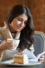 Woman reading a book at cafe