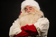 Photo of happy Santa Claus standing with hands folded