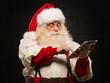 Santa Claus using tablet computer